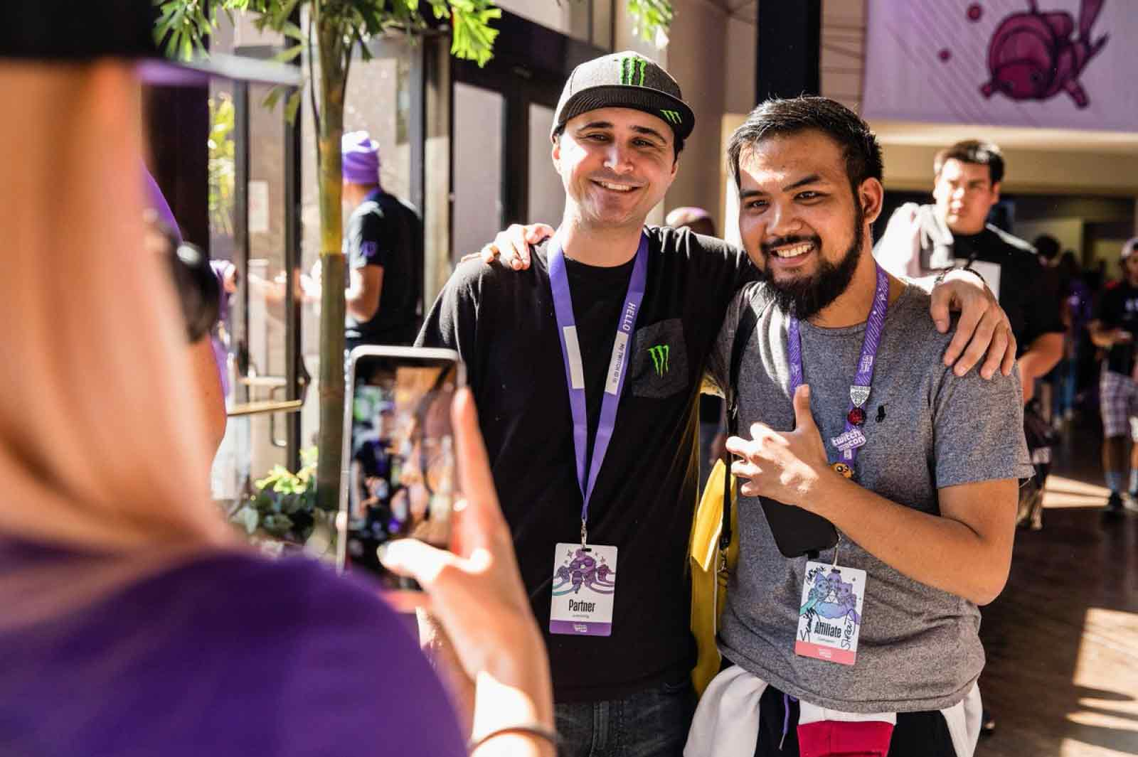 Two TwitchCon attendees pose together for a picture.