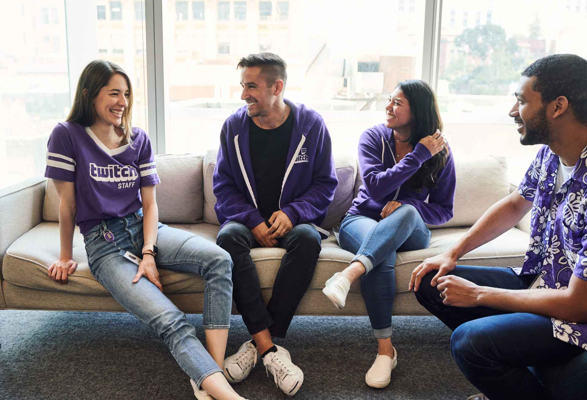 Twitch employees laughing together on a couch